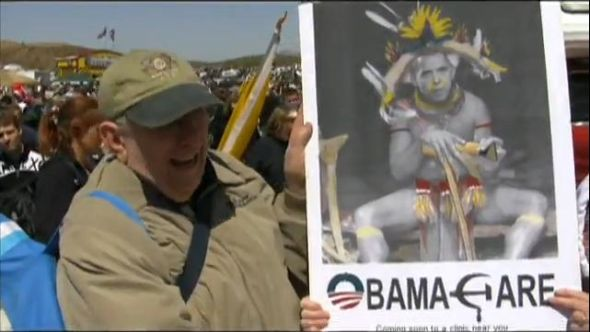Image result for sarah palin rally with supporters carrying posters with obama